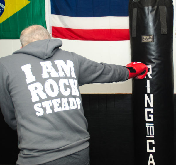 Rock Steady Boxing Seattle fighter Geof Miller on the heavy bag